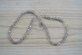 Kristalstreng transparant/zilver gefacetteerde rondellen ca. 3 x 4 mm