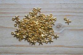 Goudkleurige bedel zeester ca. 7 x 10 mm per 4 stuks