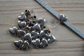 Metalen leerschuif hart ca. 11 x 12 mm per stuk
