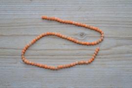 Oranje Calciet ronde kralen ca. 4 mm