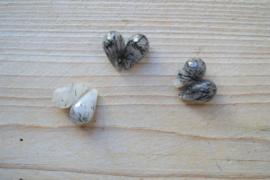 Zwart rutilated kwarts gefacetteerde ronde druppels ca. 12 x 20 mm per 2