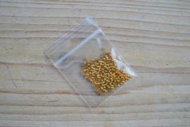 Goudkleurige knijpkralen ca. 2 mm ca. 100 stuks