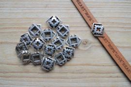 Metalen leerschuif 'boho' 10 mm ca. 15 x 19 mm per stuk