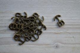 Bronskleurige leer anker klein ca. 15 x 21 mm per stuk