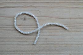 Kristalstreng wit AB glans gefacetteerde rondellen ca. 3 x 4 mm
