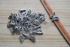Metalen leerschuif vlinder 10 mm ca. 15 x 22 mm per stuk