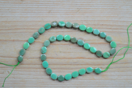 Groen gras agaat gefacetteerde platte ovalen ca. 8 x 10 mm