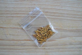 Goudkleurige knijpkralen ca. 3 mm ca. 80 stuks