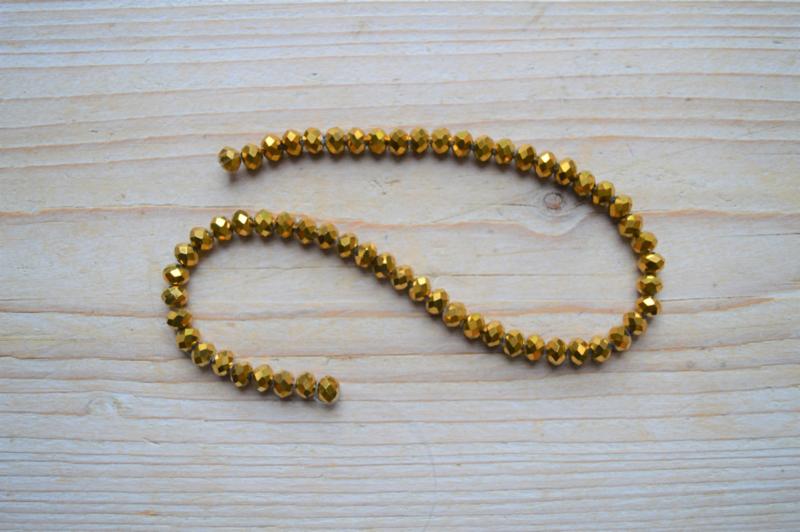 Kristalstreng goud gefacetteerde rondellen ca. 4 x 6 mm