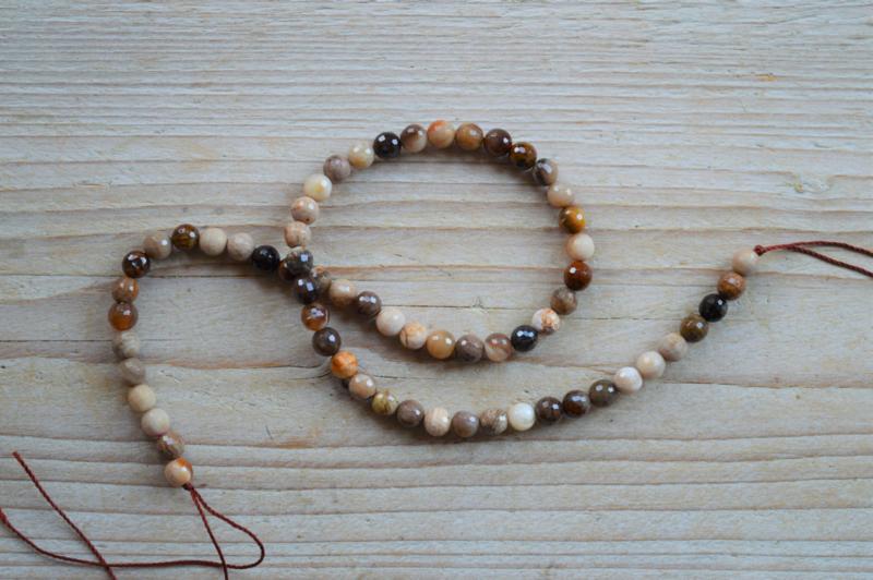 Versteinertes Holz Achat facettierte runde Perlen 6 mm