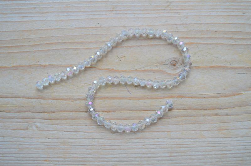 Kristalstreng transparant AB glans gefacetteerde rondellen ca. 4 x 6 mm