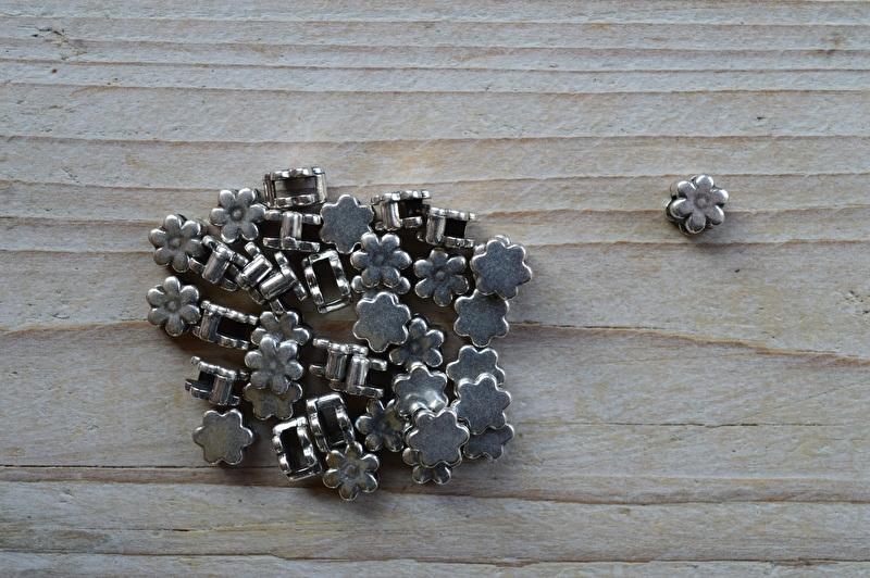 Metalen lederschieber Blume ca. 8 mm pro stück