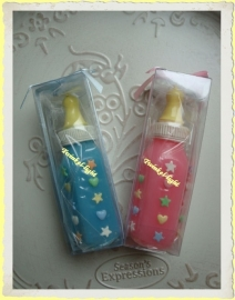 Geboorte kaars Baby zuigfles in roze en blauw