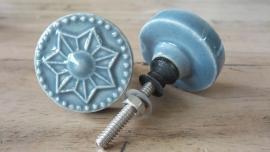 Grijze ronde porseleinen meubelknop met bloemprint