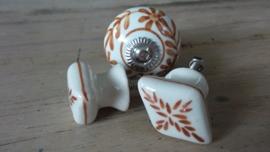 Porseleinen meubelknop wit roestbruin motief
