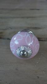 Ronde roze porseleinen meubelknop met wit bloemmotief
