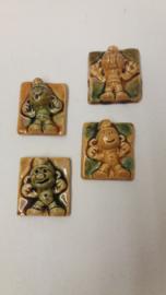 4 kleine wandbordjes met smurfen / 4 little wallplates with smurfs