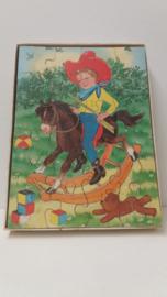 Jig-saw puzzel jongetje op hobbelpaard / Jig-saw puzzle boy on rocking horse
