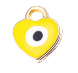 Bedel evil eye geel goud 7 mm hartje