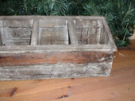Drievaks houtenbakje