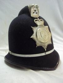 British Bobbyhelmet Mid-Anglia Constabulary.Engelse Bobbyhelm.