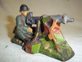 Dutch toy soldier elastolin behind MG Machine Gun.Nederlands elastolin soldaatje achter Machine geweer top staat