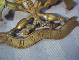 German helmet badge firedepartment UCHTE.  Brandweer embleem met plaatsnaam, beide bevestigings splitpennen nog aanwezig. mooi vuurverguld embleem