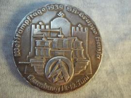German plaque silver, Wettkampftage 1939 SA-Gruppe Hansa.Hamburg 14-18 juni.  NSFK- Gruppe Nordwest. Sieger in den Gruppenwettkämpfen 1939. 5cm.doorsnee.