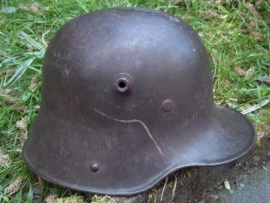 German helmet M-1916, small size ET60, very rare with white leather innerliner. Duitse helm Model 1916 ET60, ook gestempeld achterin, met wit leren binnenwerk zeldzaam