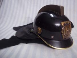 Dutch fire department helmet from the seventies. Nederlandse brandweerhelm uit de jaren  70, compleet met leren flap en brandwerende hoes, zeer goede staat.