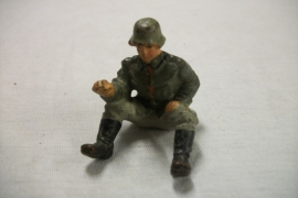 German toy soldier sitting, driver for a vehicle. Duits speelgoed soldaat chauffeur , koetsier