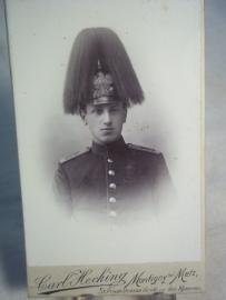 Photograph, with German officier wearing the spikehelmet with hairplume. Foto Duitse officier met pickelhaube en paardestaart
