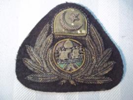 Pet embleem van een Oosterse vliegtuigmaatschappij. piloten pet embleem officier. Maleisie, Siam