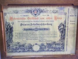 Ingelijst aandeel van het Oostenrijkse Rode Kruis. met Nederlandse belasting zegel.