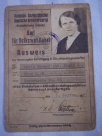 NSDAP amt fur Volkswohlfahrt. bewijs dat je voorrang kreeg in winkels als je dit bewijs liet zien, mooi gestempeld, leuk apart document