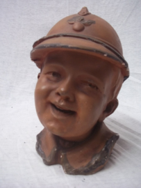 Moneybank made of terracotta Child with a French helmet nice item