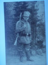 Postcard soldier with shako. Postkaart soldaat met schako en overtrek