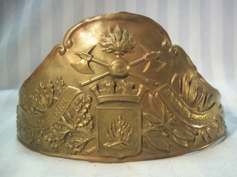 Brass helmet plate from a French helmet 1850- 1880. Helmplaat Franse brandweerhelm oud model