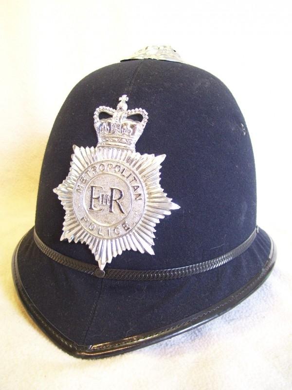 English police helmet Metropolitan, nearly mint condition. Engelse bobbyhelm als nieuw