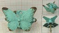 """Kastknop """" vlinder """"."""
