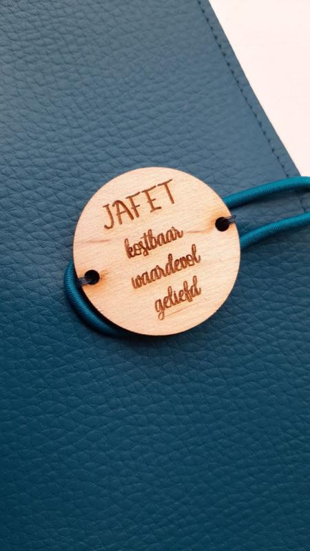 Persoonlijk houten label met de eigen naam!