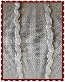 Smal zandkleurig bandje met ovale zigzagvorm