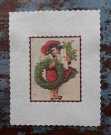 Textieltransfer meisje met hulstkrans ± 6 x 8 cm