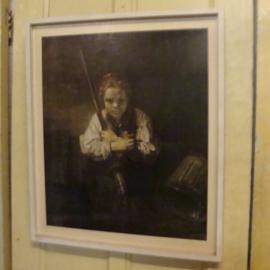 Afbeelding jongen in oude lijst