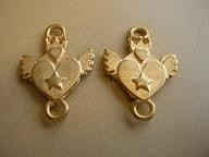 Gd/Br 190 Tussenzetsel Hart met vleugels, metaal goudkleur, mat 28x20mm