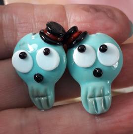 IKOC0215: DuoSet Schedels Halloween Turquoise, ca 26mm
