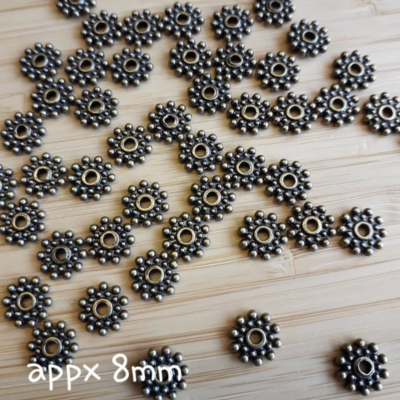 Gd 010: Spacer Bloemvormig bronskleur, ca 8mm