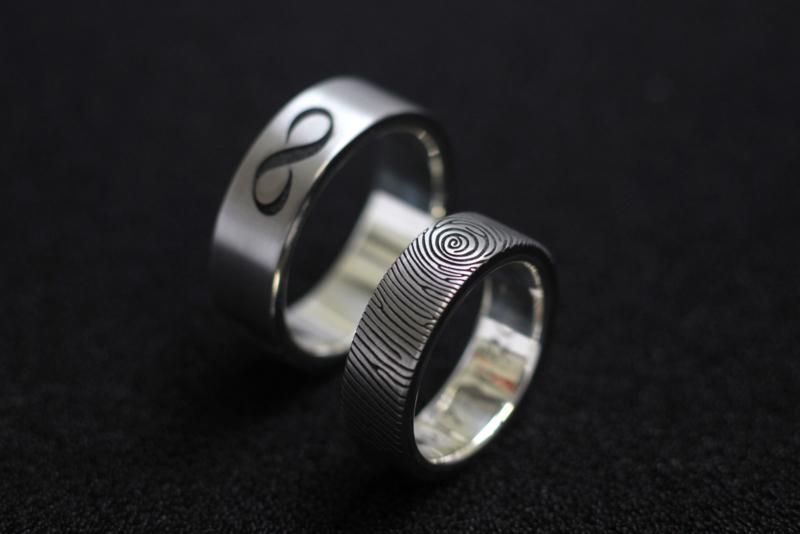 Vingerafdruk ringen met zilveren binnenzijde en zirkonium blanke buitenzijde