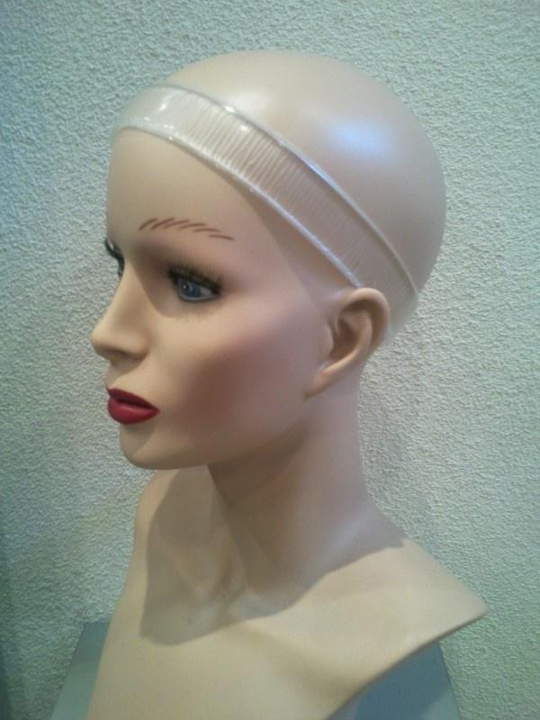 Sure-grip, siliconen band om het haarwerk beter en vaster  te laten zitten.