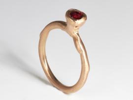 Dripping art ring with red corundum